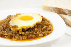Stew with baked onion, egg and meat Stock Photography