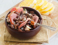 Stew of beans  and smoked sausages Royalty Free Stock Images