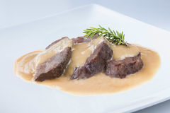 Stew beef cheeks with wine sauce spanish recipe. Delicious traditional recipe from spain cheek on a white plate Royalty Free Stock Photo