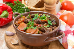 Stew with beef, prunes, vegetables and parsley Royalty Free Stock Photos