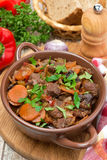 Stew with beef, prunes, vegetables and parsley, top view Royalty Free Stock Photography