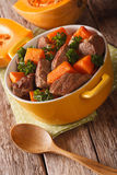 Stew beef with pumpkin closeup in the pan. vertical Stock Photo