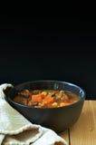 Stew. Bowl of stew against a dark background Stock Photo