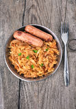 Stew cabbage with grilled sausages Stock Image