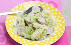 Stew of cabbage with sausage Stock Image