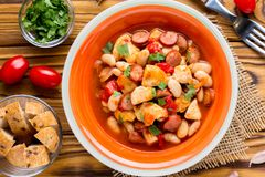 Stew with chicken, sausages, beans, tomatoes, homemade autumn di stock photo
