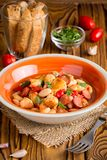 Stew with chicken, sausages, beans, tomatoes, homemade autumn di stock images