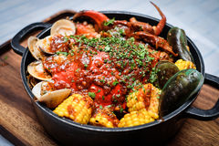 Stew of clams, crabs and corns Stock Photo
