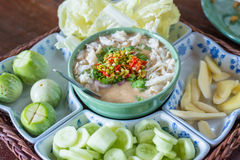 Stew crab with coconut milk dip sauce and fresh vegetables Stock Photo