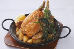 Stew of fried whole chicken with rosemarry, lemon, potatoes and Stock Photography
