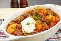 Stew Hungarian Beef Goulash Gulyas with Sour Cream Royalty Free Stock Photo