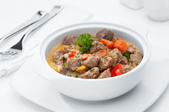Stew meat. Close  up view of nice yummy meal  on white back Stock Photos
