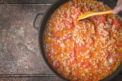Stew meat with onion and tomatoes in the pan top view Royalty Free Stock Images