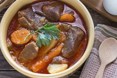 Stew with meat and vegetable in ceramic bowl on table Stock Images