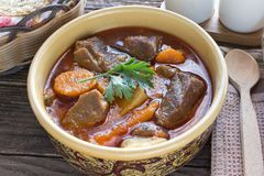 Stew with meat and vegetable in ceramic bowl on table Royalty Free Stock Image