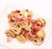 Stew of mushrooms with bacon Stock Images