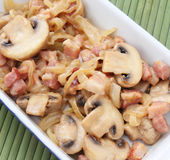 Stew Of Mushrooms With Bacon Royalty Free Stock Images