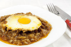 Stew with onion, egg and sausages Royalty Free Stock Image
