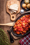 Stew with peppers, onions and sausages. Stock Photos
