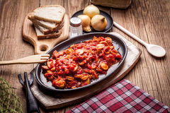Stew with peppers, onions and sausages. Royalty Free Stock Images