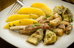 Stew of pork, artichoke and potato royalty free stock images