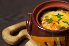 Stew pot with cheese Royalty Free Stock Image