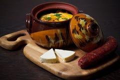 Stew pot with gourmet food stock photos