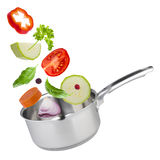 Stew pot with tossed up vegetables isolated on white Stock Images
