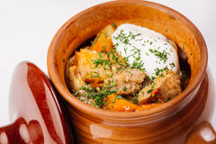 Stew with potatoes in a clay pot Stock Photos