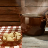 Stew potatoes and fish in clay plate ration Stock Photos