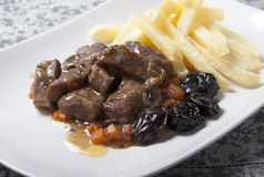 Stew with prunes, carrots and onions garnished Stock Photo