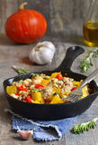 Stew from pumpkin,beans and ground meat with rosemary. Stock Photos