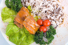 Stew with rice, cherry tomatoes and lettuce. Stew with rice, red cherry tomatoes and lettuce Stock Photo