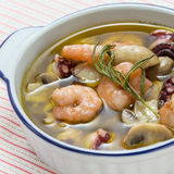Stew of shrimp soup with octopus, rosemarry, mushroom, and sea c Stock Images