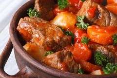 Stew in tomato sauce with vegetables and herbs macro. top view Stock Photography