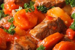 Stew in tomato sauce and vegetables macro horizontal. Background Royalty Free Stock Photos