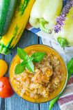 Vegetable stew served in a glass bowl on a wooden background. Selective focus stock photography