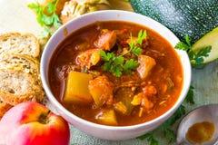 Stew zucchini stewed vegetables meat food meal vintage Stock Photo