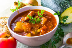 Stew zucchini stewed vegetables meat food meal vintage Royalty Free Stock Images