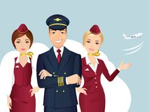 Steward (hôtesse de l'air) de pilote et des lignes aériennes commerciales sur le fond bleu Photos stock