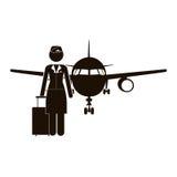 Steward (hôtesse de l'air) et avion noirs de silhouette Images libres de droits