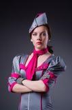 Steward (hôtesse de l'air) féminin Photographie stock libre de droits