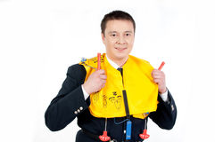 Steward with life jacket. Male steward showing how to use a life jacket Stock Photo