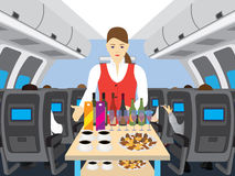 Stewardess в салоне самолета Стоковые Фото