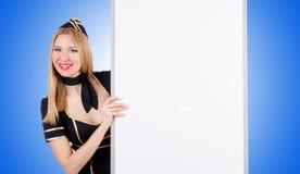 Stewardess женщины с пустой доской Стоковое Изображение RF