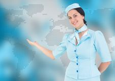 Stewardess against blue map Stock Photography