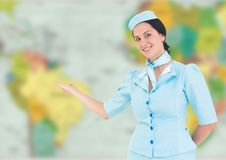 Stewardess against blurry map Stock Photos