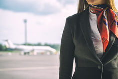 Stewardess on the airfield. Royalty Free Stock Photo