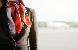 Stewardess on the airfield. Stock Photo