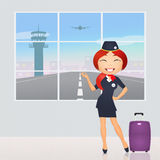 Stewardess in airport Royalty Free Stock Photography